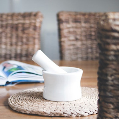 mortar and pestle sitting on a table