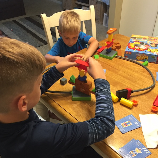 boys playing build or boom game