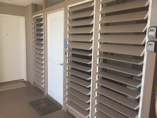 condo door with slats for front porch area