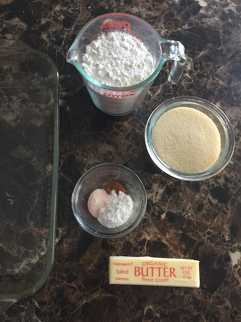 flour, sugar, butter beside pan