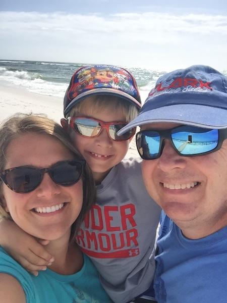family standing in front of ocean