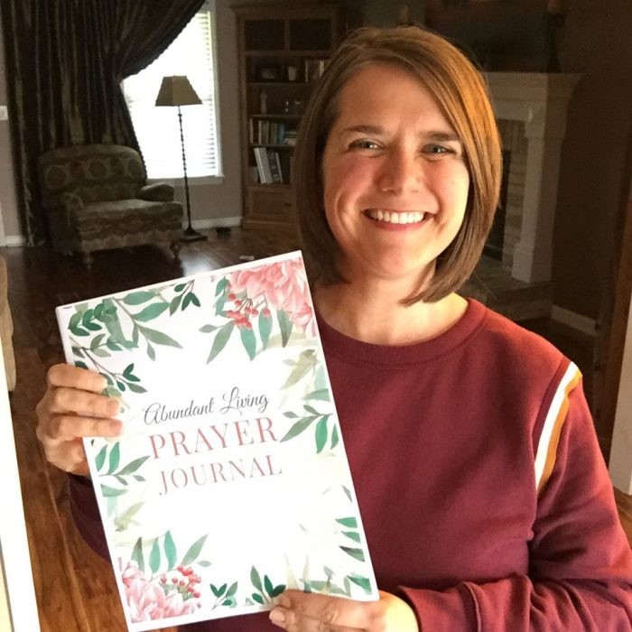 holding printable prayer journal