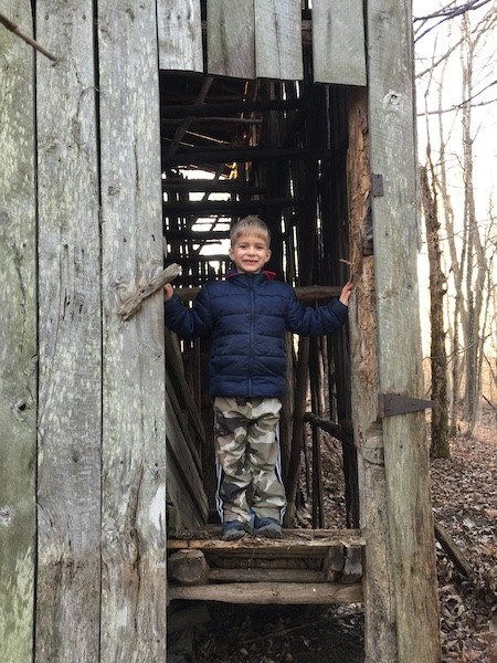 little boy in old barn