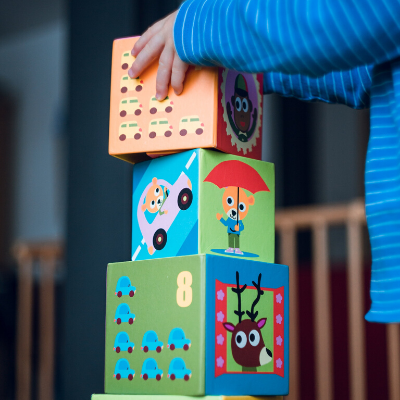 child stacking blocks