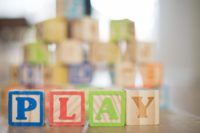 wooden toy blocks spelling play