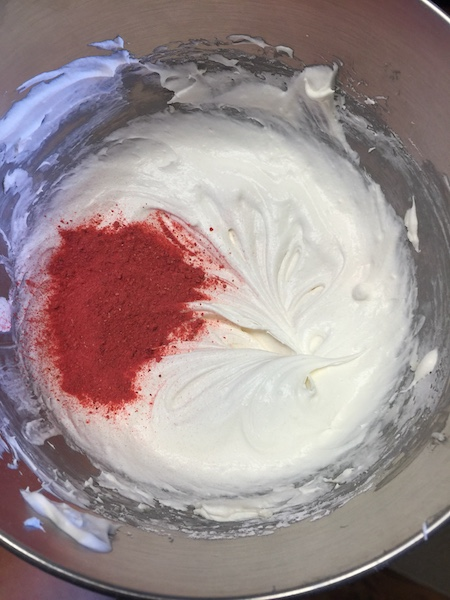 cremates cheese mixture with crushed strawberry on top
