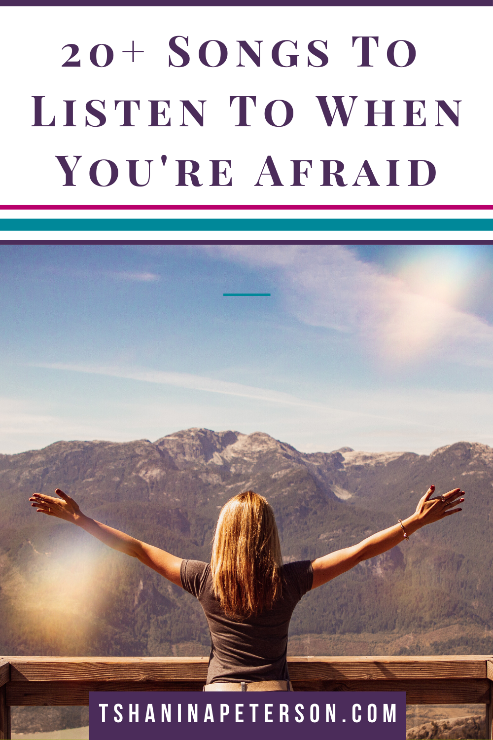 woman on mountaintop with outstretched arms