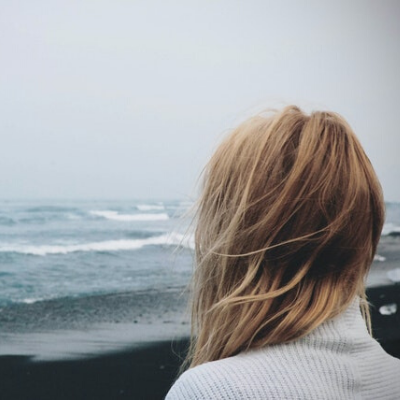 woman overlooking ocean