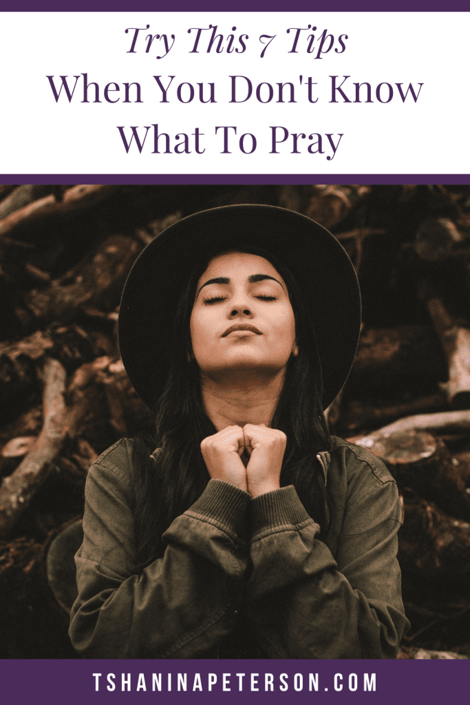 woman with hands clasped together praying