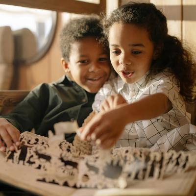 black children reading a pop up book