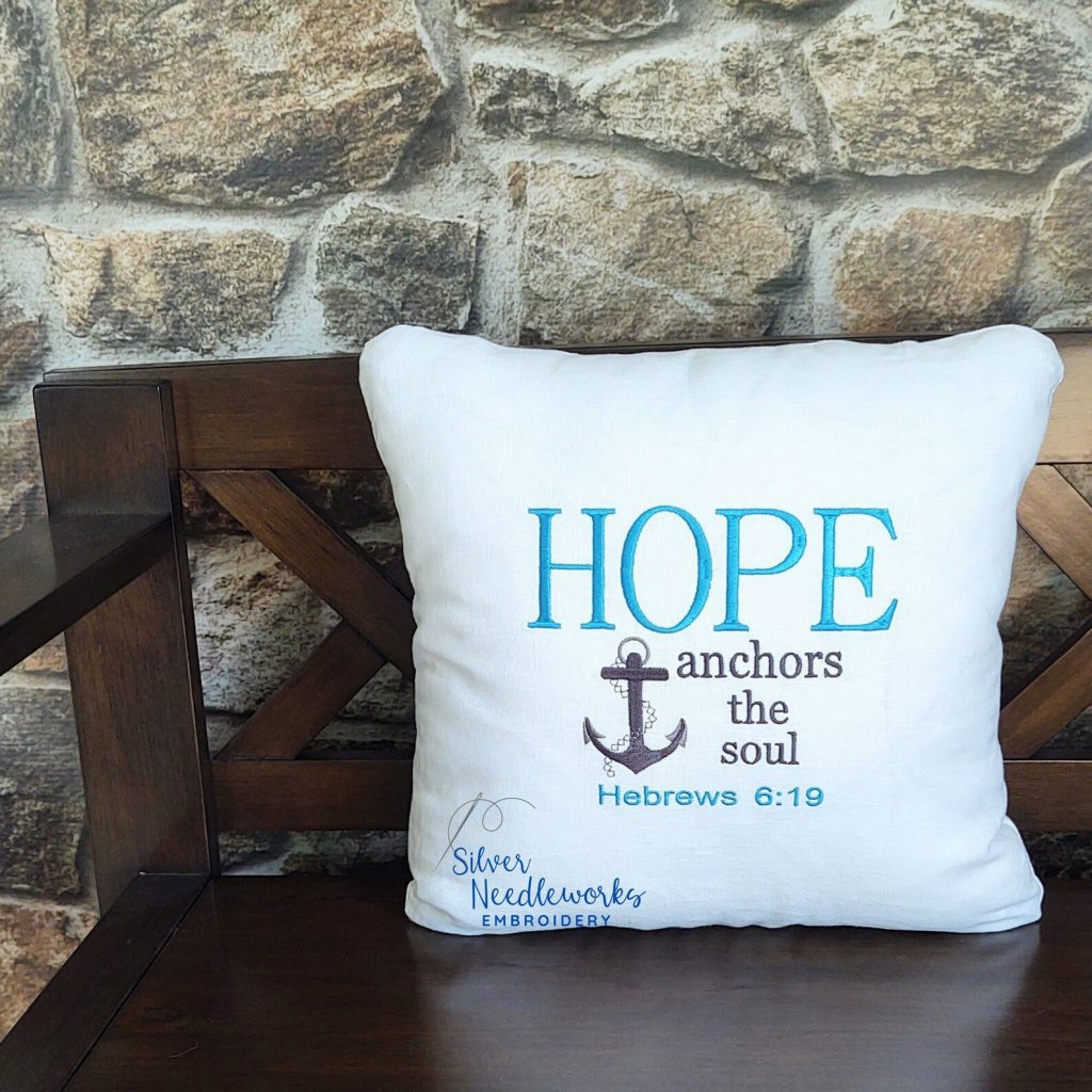 hope anchors the soul pillow on brown bench