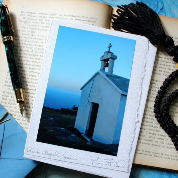 greeting card of a church on top of a book